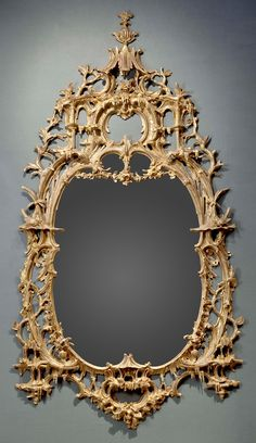 An exceptional English rococo carved and gilded mirror frame in the style of Thomas Johnson (1750 - 1760)