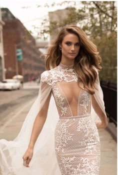 This wedding dress is from Berta's spring 2018 bridal collection. It is handmade lace-embroidered wedding gown with a netting underlay, plunging neckline and a dramatic long train. It was easy to move around in (dancing, sitting). If you are looking for a wedding dress that turns heads then this the dress for you! #laceweddingdress #weddingdressforsale #designerweddingdress #usedweddingdresses