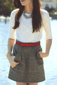 Cute plaid skirt, white textured shirt and tiny red belt.