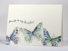 Heather Telford's Watercolor Butterflies.  Clear Embossed on watercolor paper and colored with aqua pen using direct stamp to acrylic block.  Intensity added with watercolor pencil and blended with water.  Thin wire strung beads for body and antenae.