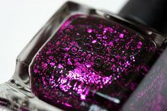 Gorgeous! I love the way the fuchsia glitter looks against the inky black base. Looking for a drugstore version? Revlon also made a copy of this polish called Facets of Fuchsia (which I have - it's great!).
