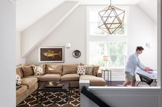 Check out that great pendant!! Transitional Family Room by Williams Design Studio