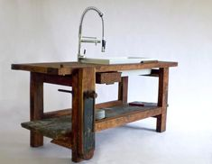 A kitchen island made from a carpenter's work bench. Designer Elisa Cavani of Bologna-based Manoteca specializes in pieces made from reclaimed materials