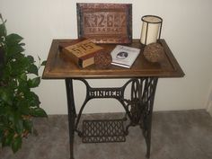 Old Singer peddle sewing machine based transformed into table simply by adding a cabinet door.
