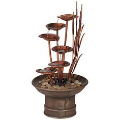 """Water Lilies and Cat Tails 33"""" High Fountain       Water lilies and cat tails fountain.     Copper finish metal.     Faux aged copper finish cast resin.     River rocks are included.     Cord measures 10-feet.     Comes with fountain pump.     33"""" high.     16"""" wide.   $170"""