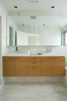light wood cabinetry in bathroom (looks like bamboo), with white counters.  I don't like the raised sinks though.