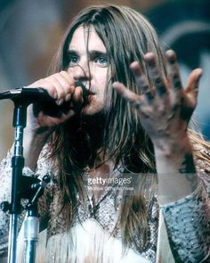 YOUNG OZZY OSBOURNE, singing live on stage . HEAVY METAL T-SHIRTS and METALHEAD COMMUNITY BLOG. The World's No:1 Online Heavy Metal T-Shirt Store & Metal Music Blog. Check out our Metalhead Clothing and Apparel Store, Satanic Fashion and Black Metal T-Shirt Stores; https://heavymetaltshirts.net/