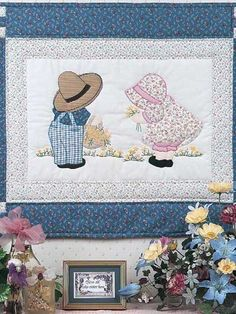 "Combine piecing and embroidery in this charming Sunbonnet Sue and Overall Bill design. Size: 22"" x 28"". Skill Level: Intermediate"