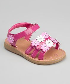 Bashful bellas experience all the comfort and style these snazzy sandals have to offer. A shiny patent finish and flower embellishments pair with an adjustable over the foot strap and adjustable ankle strap for fashion that's absolutely bellissima. Toddler Shoes, Kid Shoes, Girls Shoes, Baby Shoes, Kids Sandals, Flat Sandals, Little Girl Shoes, Boys And Girls Clothes, Little Fashion