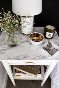 Marble patterned vinyl on a side table. Get your vinyl from www.vinylwarehouse.co.uk