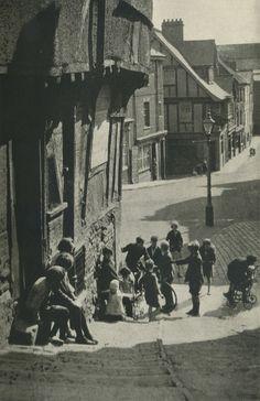 Children play on the street in Exeter, Devon, UK 1930, no cars!