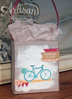 I found this on stampinup.com The stamp used here is in this month's Paper Pmpkin.  Use direct to paper with your white pad and let dry  Stamp the bike and add the tags.