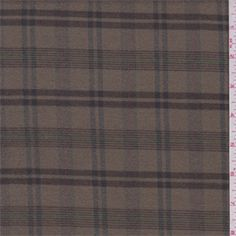 Medium/light weight wool and polyester blend suiting fabric. Yarn dyed plaid in cocoa, blue, green, and brick. Soft, slightly brushed surface with a dry hand/feel. Suitable for skirts, slacks, suits and jackets. Dry clean for best results. Imported from Japan.Compare to $15.00/yd