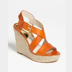 Michael Kors Giovanna wedge Michael Kors Giovanna wedge in tangerine.  Worn once.  No flaws except for the soles from wearing. MICHAEL Michael Kors Shoes Wedges