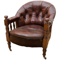 English Victorian Tufted Leather Barrel Back Open Armchair | From a unique collection of antique and modern armchairs at https://www.1stdibs.com/furniture/seating/armchairs/