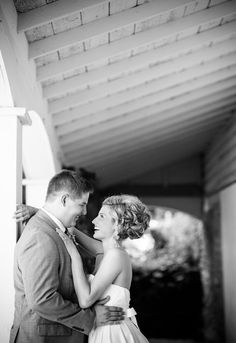 brid and groom laughing at Mayowood Stone Barn wedding in Rochester MN | Photo: Janelle Elise Photography
