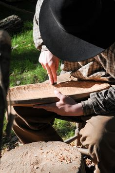 An artisan carving a wooden bowl in our history museum @cracker.country.livinghistory during the Florida State Fair.
