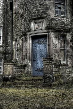 Nature is starting to reclaim this amazing main entrance of an abandoned castle in Scotland. I adore the old blue door with the exquisite ornate hinges. So unique! - Love Scotland and Ireland! Always really cool stuff to see. Abandoned Castles, Abandoned Mansions, Abandoned Places, Haunted Places, Old Buildings, Abandoned Buildings, Beautiful Buildings, Beautiful Places, Belle Image Nature