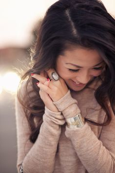 Love everything about her style: her hair, her ring, her nails, her sweater, her bracelet. All perfect.