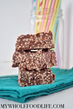 Chocolate Rice Crispy Squares.  Just a handful of simple ingredients and minutes to make.  Unlike the traditional recipe, these are vegan and gluten free!!