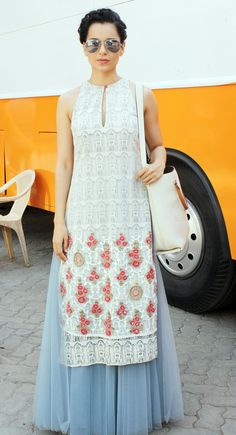 "The ""Queen"" Kangana Ranaut carries off her bohemian look well with perfectly matched avaitors."
