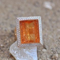 Topaz trouble in this topaz and diamond ring set in 18k yellow gold, handmade by Ricardo Basta Fine Jewelry