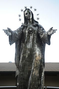 Our Lady of Peace, statue of Mary, halo of stars, arms open, approximately life sized Marian statue, stainless steel, inner courtyard, Our Lady of Peace Church and Shrine, Santa Clara, California, USA