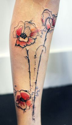 Fun abstract Poppy tattoo this was the original basic idea for my tattoo I love this but it was so fun letting the tattoo artist do his thing abd get creative