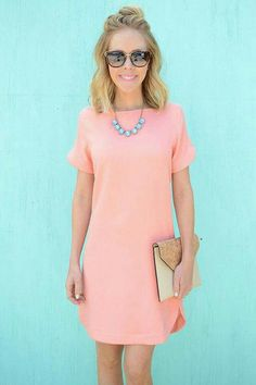 Short pink dress, blue necklace