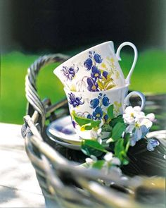Teacups, greens and basket all pull the look together