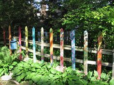 Brighten up the yard by colorfully painting your fence with the kids.