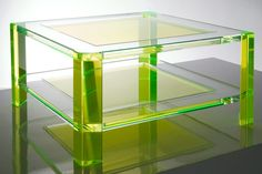 The green embellishments of the Radiant Acrylic Coffee Table introduce both clarity and color to a room.