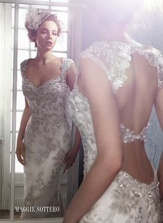 An exquisite bead embroidered lace sheath wedding dress, Jade by Maggie Sottero's Spring 2015 collection, complete with sparkling Swarovski crystal and stunning double keyhole back.