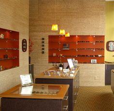 Wink Optical. Love how they used the accent color behind the shelves.
