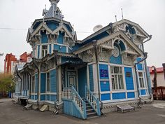 Russia, Tomsk.  Traditional Russian house with traditional satellite antenna.