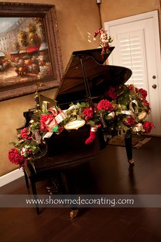 Christmas garlands aren't just for mantles and doorways.  This garland looks gorgeous draped over this elegant piano.  www.showmedecorating.com