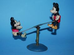 Mickey & Minnie Mouse on See-Saw  Celluloid toy from 1930s/ebay