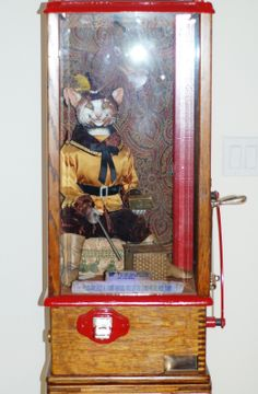 PUSS-IN-BOOTS BY ROOVER BROTHERS, ARCADE FORTUNE TELLER MACHINE CIRCLE 1904. Saw $21,000  asking price for one on ebay.