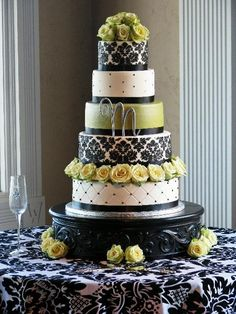 """4-tier round wedding cake on custom-made cake stand.  Black damask pattern on 6"""" and 12"""" tiers.  Bottom tier quilted with black be..."""