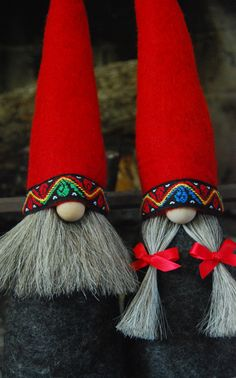 Mr and Mrs Gnome in all natural materials. Wool felt for body and hat, wooden nose, horsehair beard and braids and traditional Norwegian woven wool ribbon on the brim of the hat.