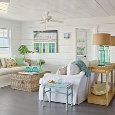 Beach cottage living room idea with large wicker trunk coffee table and sea green glass lamps.... Sea green is a nice color for beach cottage style decorating... it doesn't have to be blue in order to be beachy! #livingroomideas #beachcottage