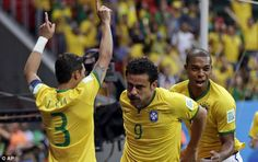 Gap: The Brazilian forward wheels away to celebrate giving the Selecao a 3-1 lead...