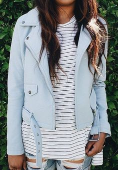 A pastel blue leather jacket, a striped t-shirt, and distressed jeans.