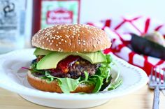 Boyfriend-Approved Spicy Black Bean Burgers Recipe Main Dishes with black beans, water, ground flax, jalapeno chilies, garlic, tomato sauce, panko breadcrumbs, cumin, salt, corn, avocado, olive oil