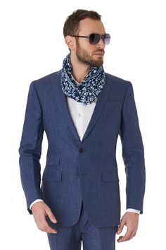 This tailored fit indigo linen jacket is 100% linen. It features two outer flap pockets, a ticket pocket, three inner pockets, a twin vent and is half lined. Available with matching trousers: 965113756. This lightweight jacket is ideal to wear to a summer wedding or for a smart casual look.