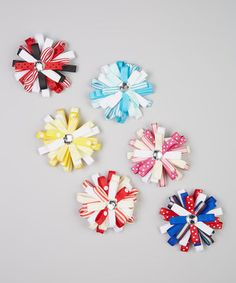 Whether they're the start of a collection or another addition, this set of clips brings something sweet to every girl's hair or headband. With sparkling rhinestone centers that playfully glint in the sun, they pair perfectly with everything from frilly frocks to everyday duds.