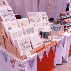 risers for displaying handmade paper goods at a craft fair