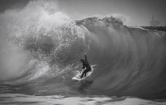 Surfer taking advantage of king tide in Seal Beach California while us photographers dodged the rogue waves...