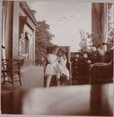 15 Haunting Photos Of The Romanov Family / the 2 youngest children showing how much they love each other