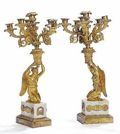 A pair of six-light late Empire gilt bronze and white marble candelabra. Presumably Russian, first half of the 19th century. H. 56 cm. (2).